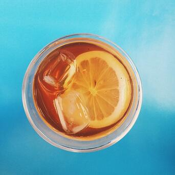top view of a glass of iced tea with a lemon in