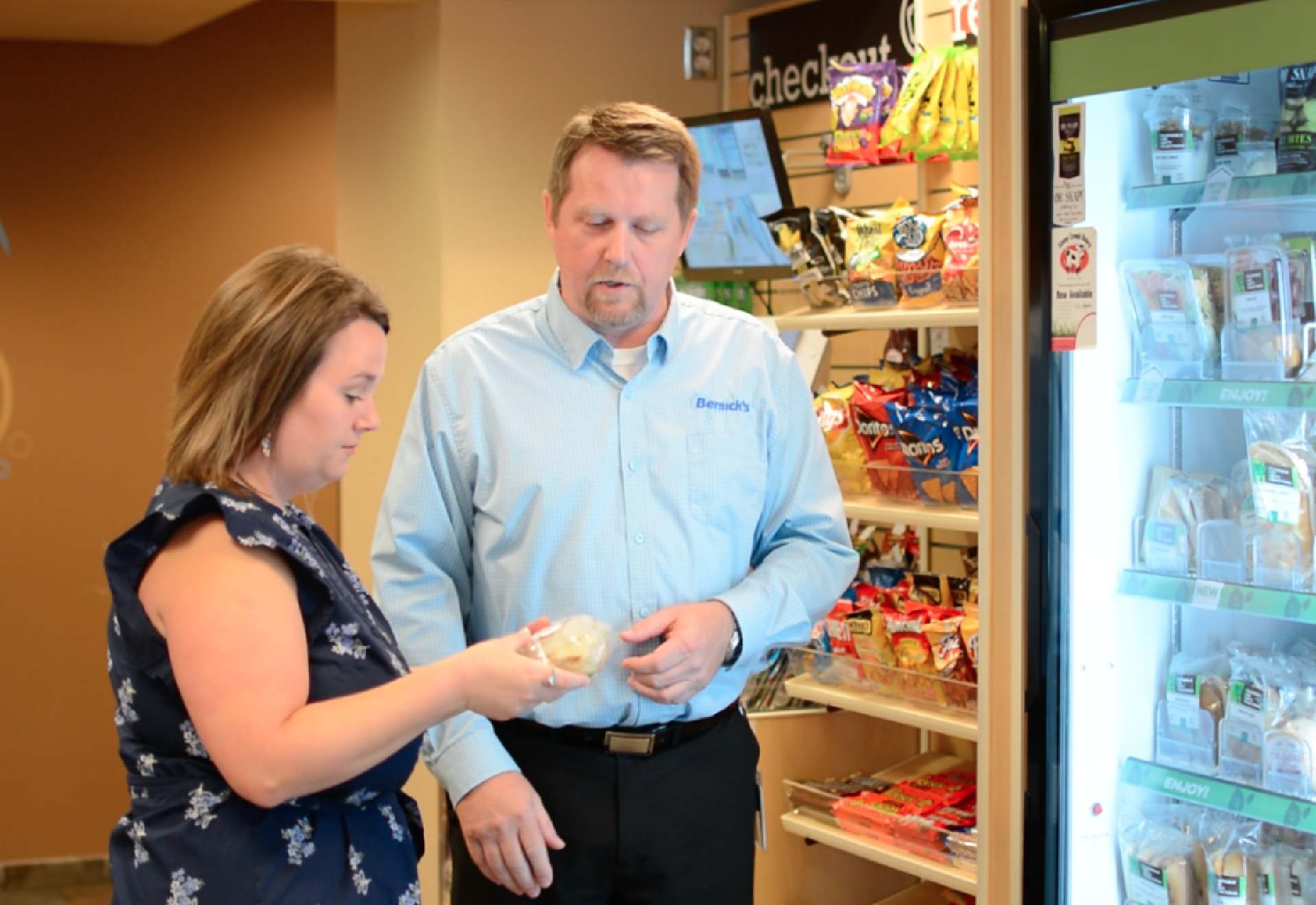 Bernick's Employee Treating Guest at Micro Market