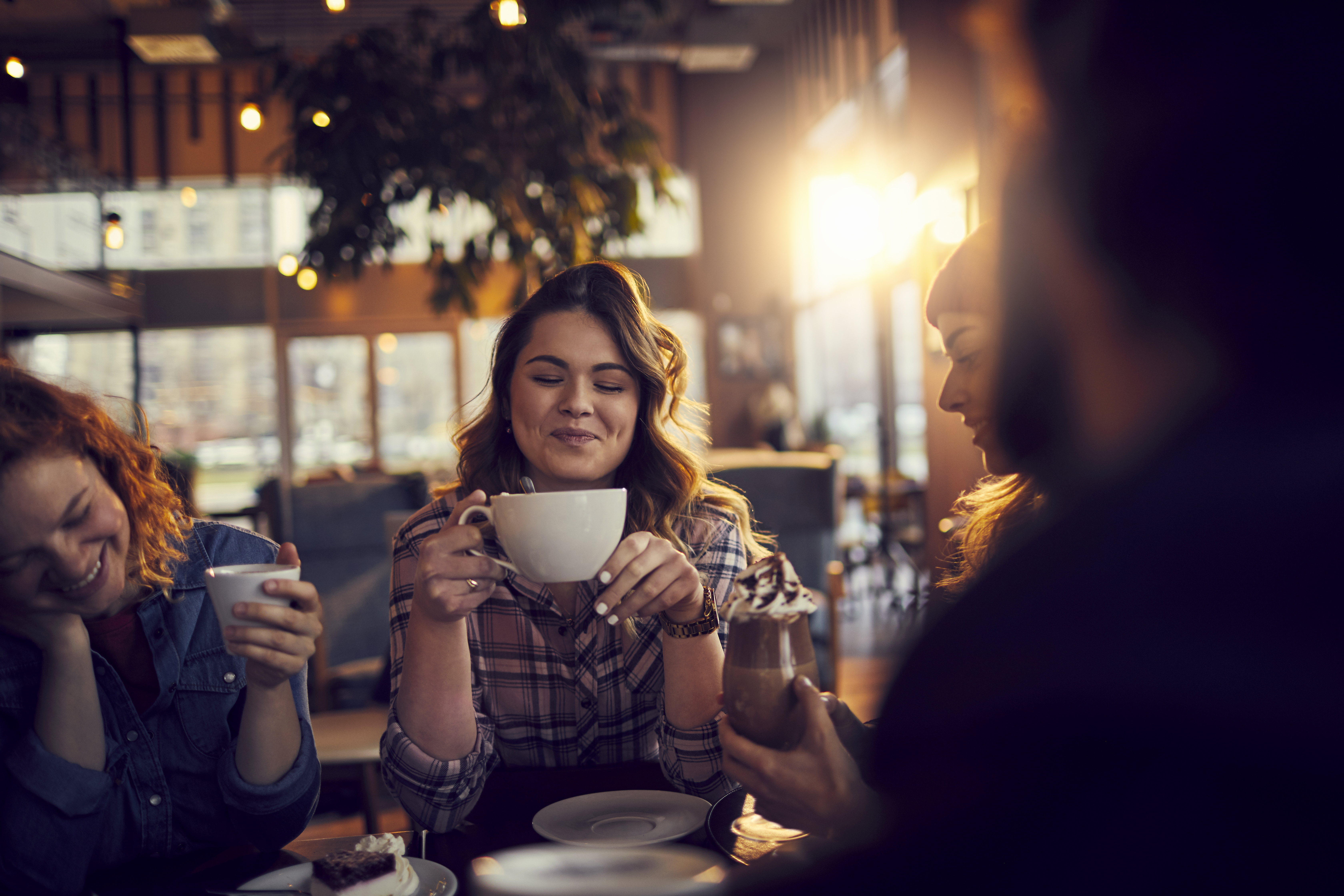 Girl in a coffeeshop with friends